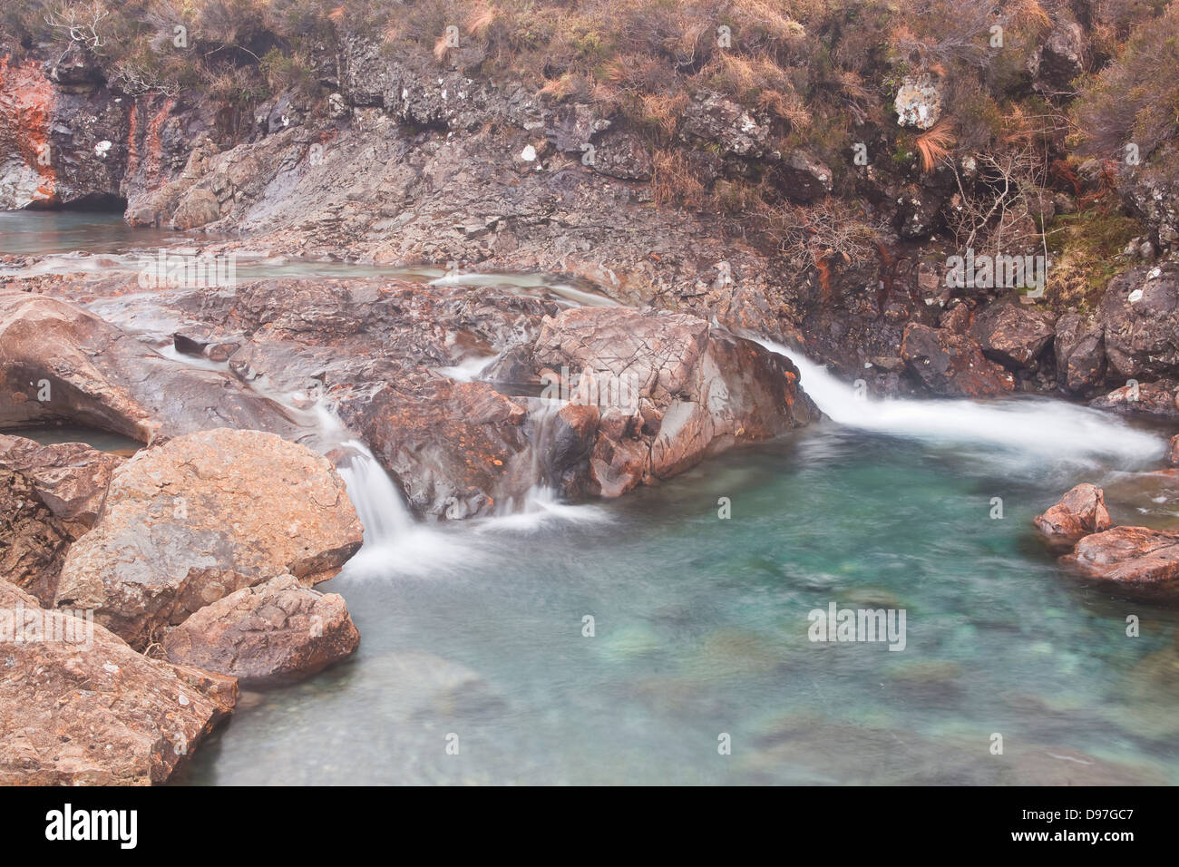 The turquoise waters of the Fairy Pools on the Isle of Skye. - Stock Image