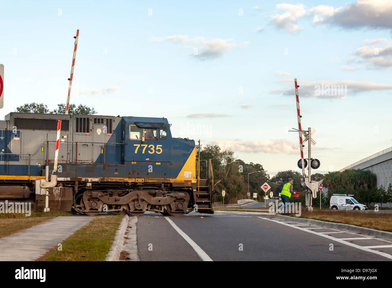 CSX engine 7735 slowly pulls a freight train through a