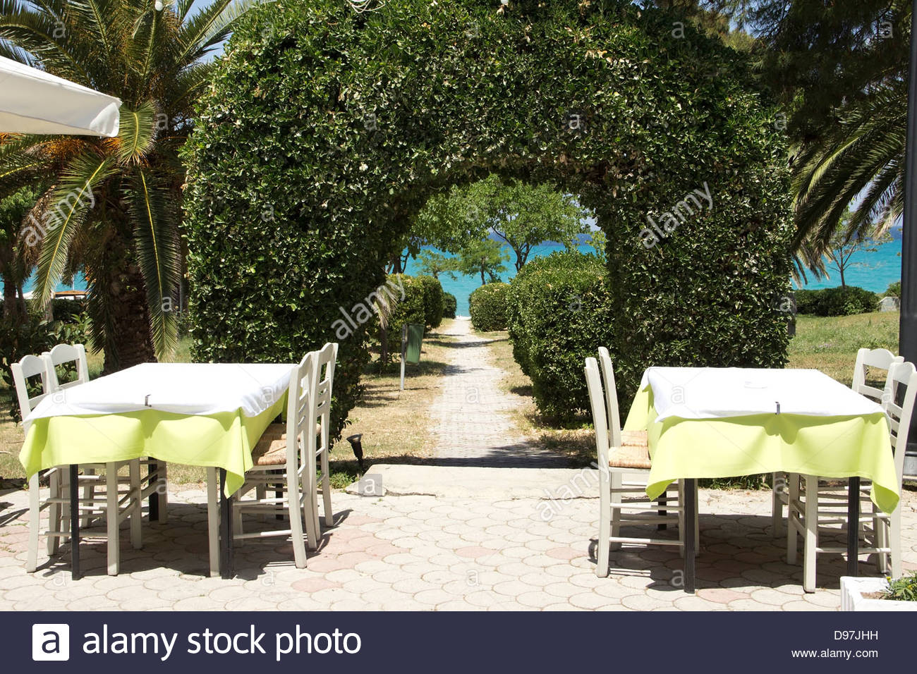 mediterranean outdoor furniture. Two Dining Tables In The Restaurant Near Mediterranean Garden Outdoor Furniture I