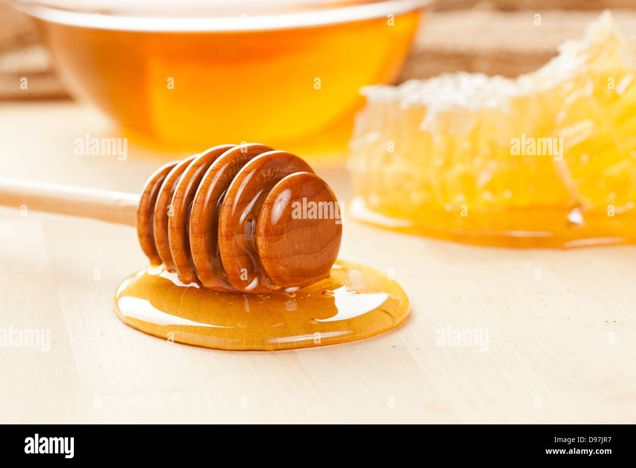 Golden Organic Honey against a back ground - Stock Image