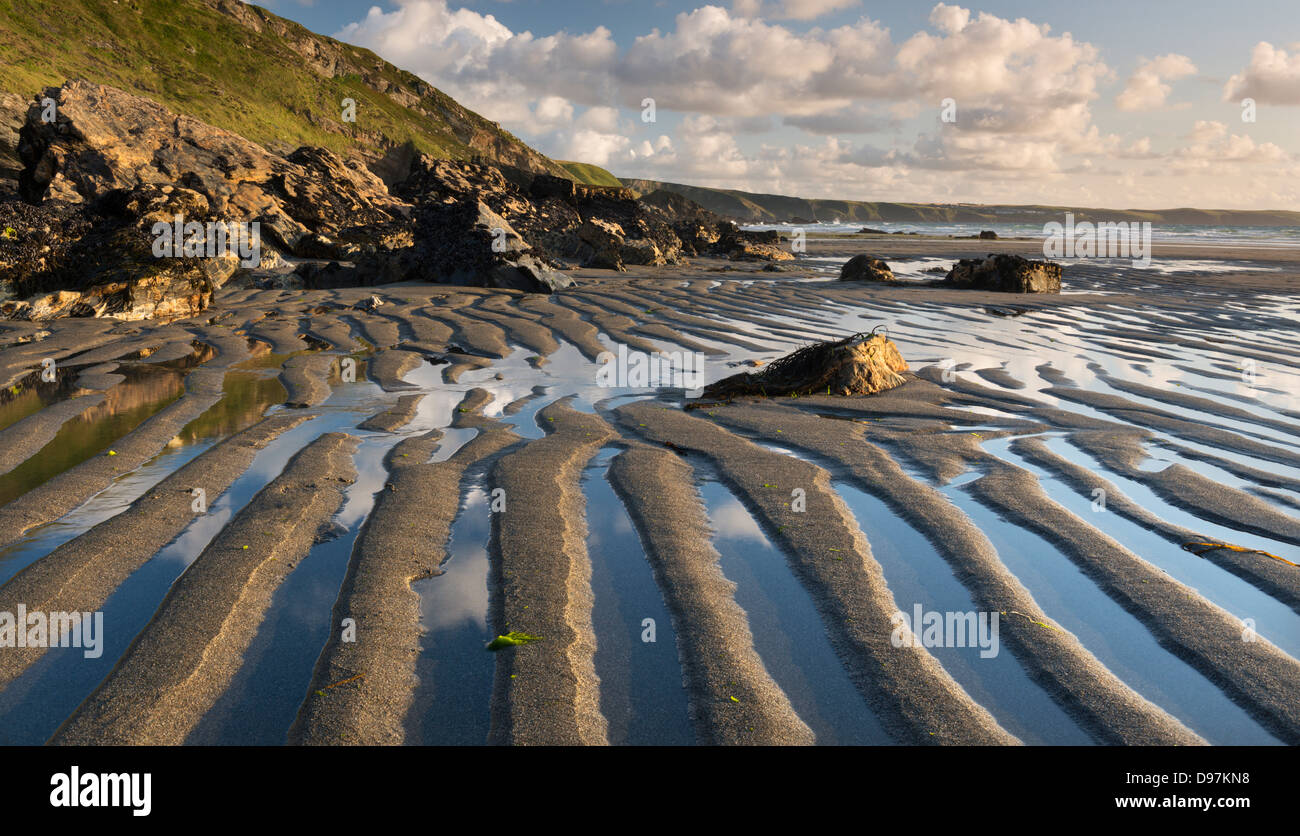 Patterns in the sand at low tide on Tregardock Beach, Cornwall, England. Summer (July) 2012. - Stock Image
