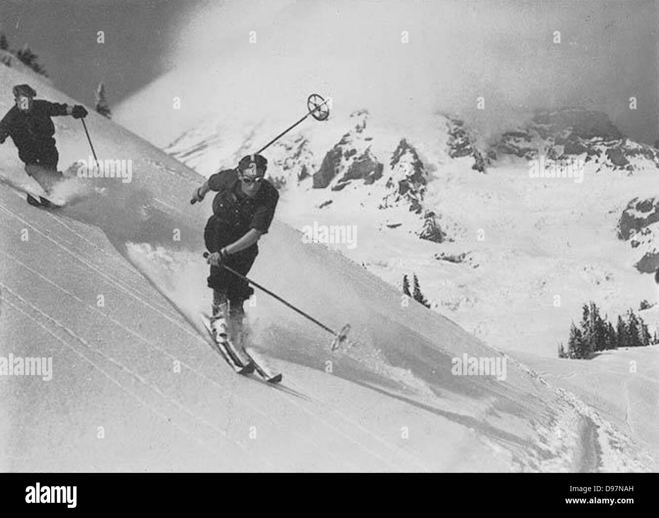 Two downhill skiers at Alta Vista in Paradise Park, Mount Rainier National Park - Stock Image