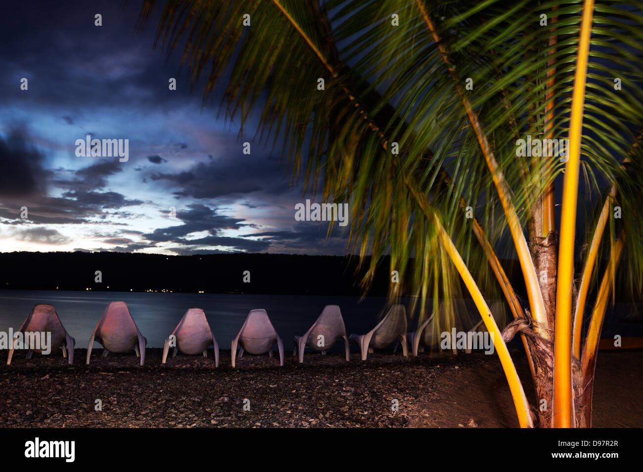 Sunset on Hideway Island, Vanuatu. Efate Island in the background. - Stock Image