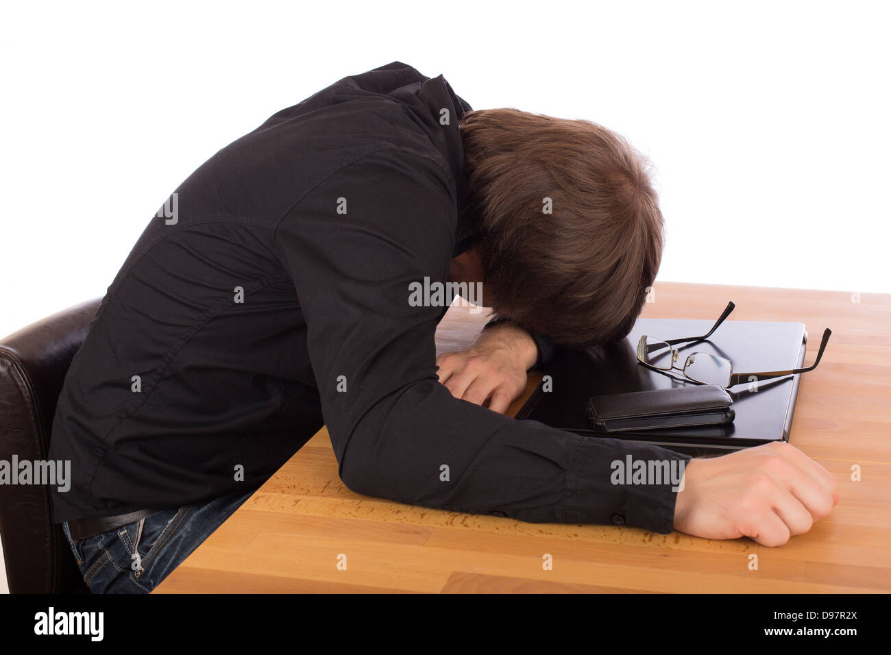 Business man sleep on his laptop. Isolated on a white background. - Stock Image
