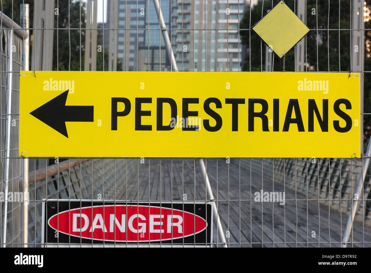 Pedestrians this way - the sings seen on the fenced construction site in the center of the city - Stock Image