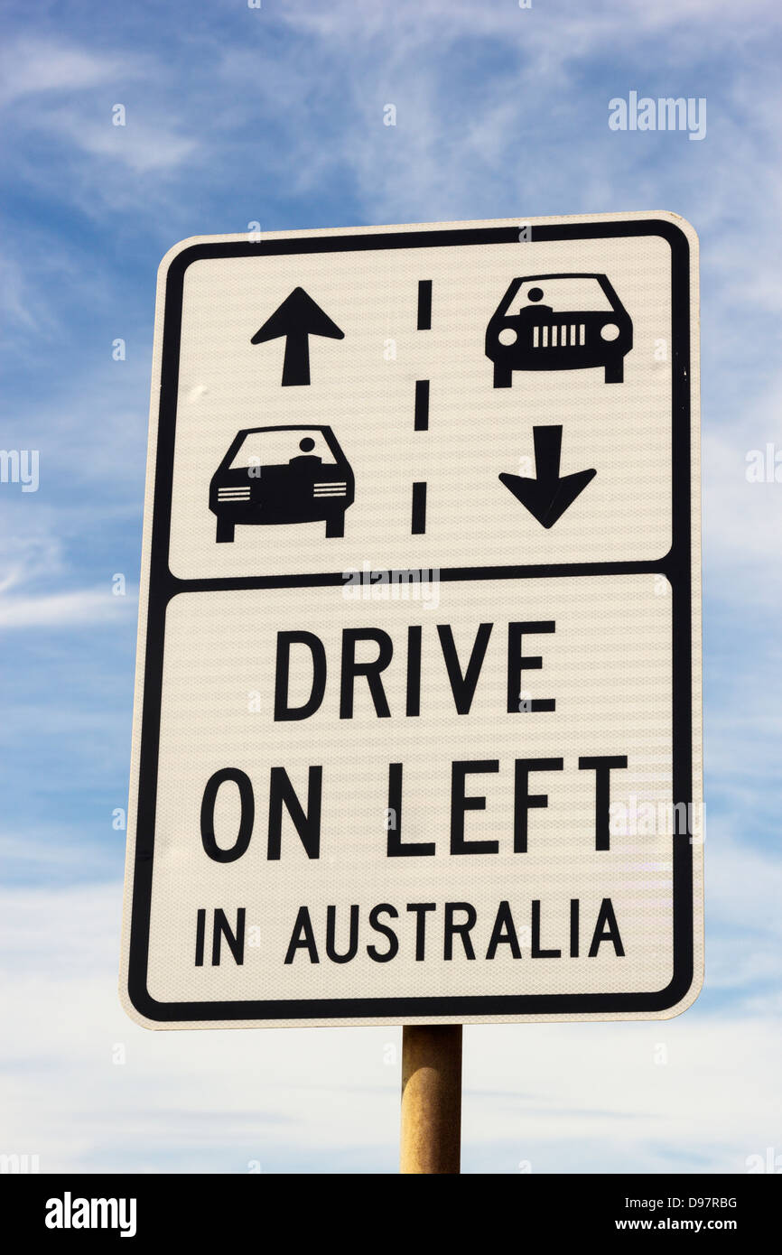 Drive on left in Australia sign seen against cloudy sky - Stock Image