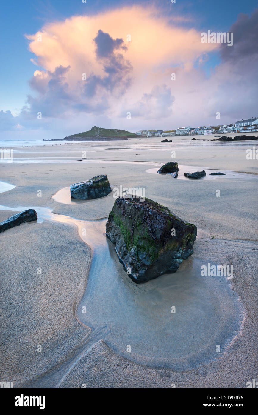 Sunset at low tide on Porthmeor Beach, St Ives, Cornwall, England. Stock Photo