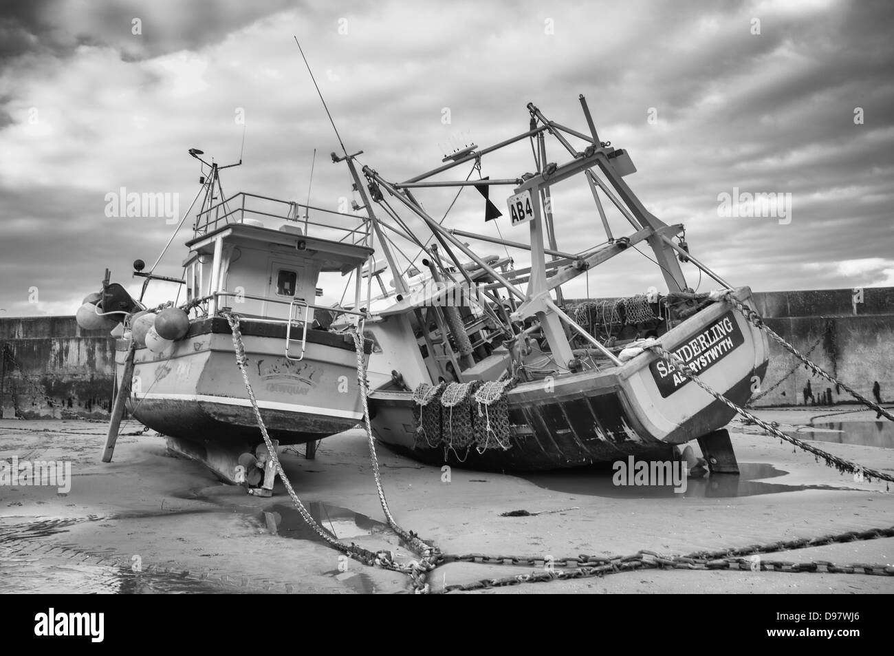 Fishing boats at New Quay Harbour West Wales ceredigion mono Stock Photo