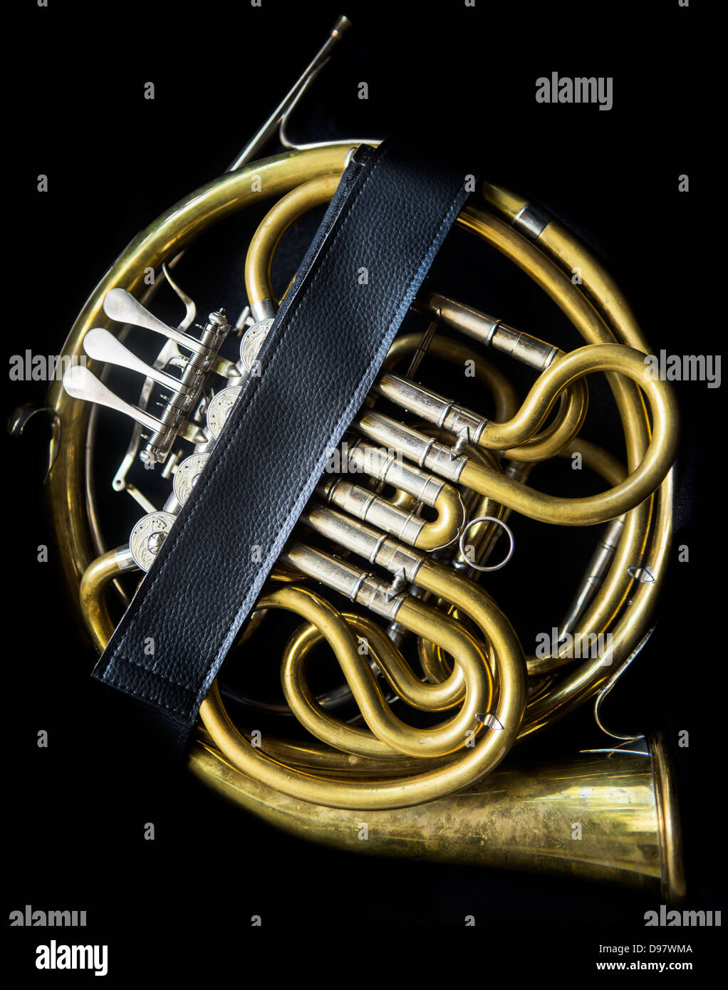 Golden french horn without a bell and mouthpiece in the horn case - Stock Image