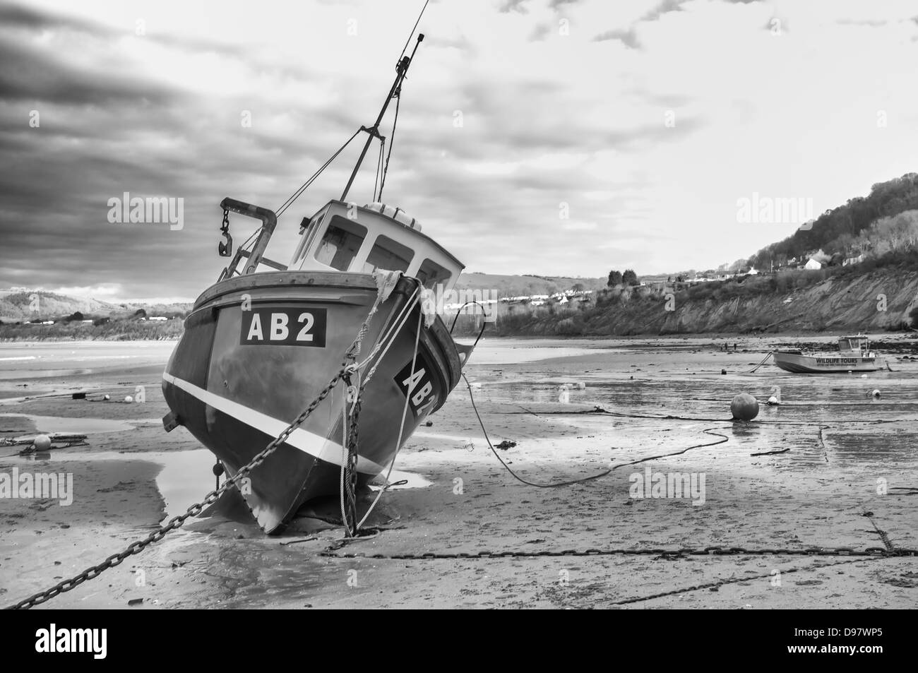 Fishing boat AB2 at New Quay Harbour West Wales ceredigion mono Stock Photo