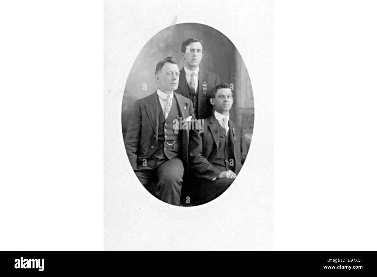 Photographic postcard of three IWW members c. 1920s-1930s. - Stock Image