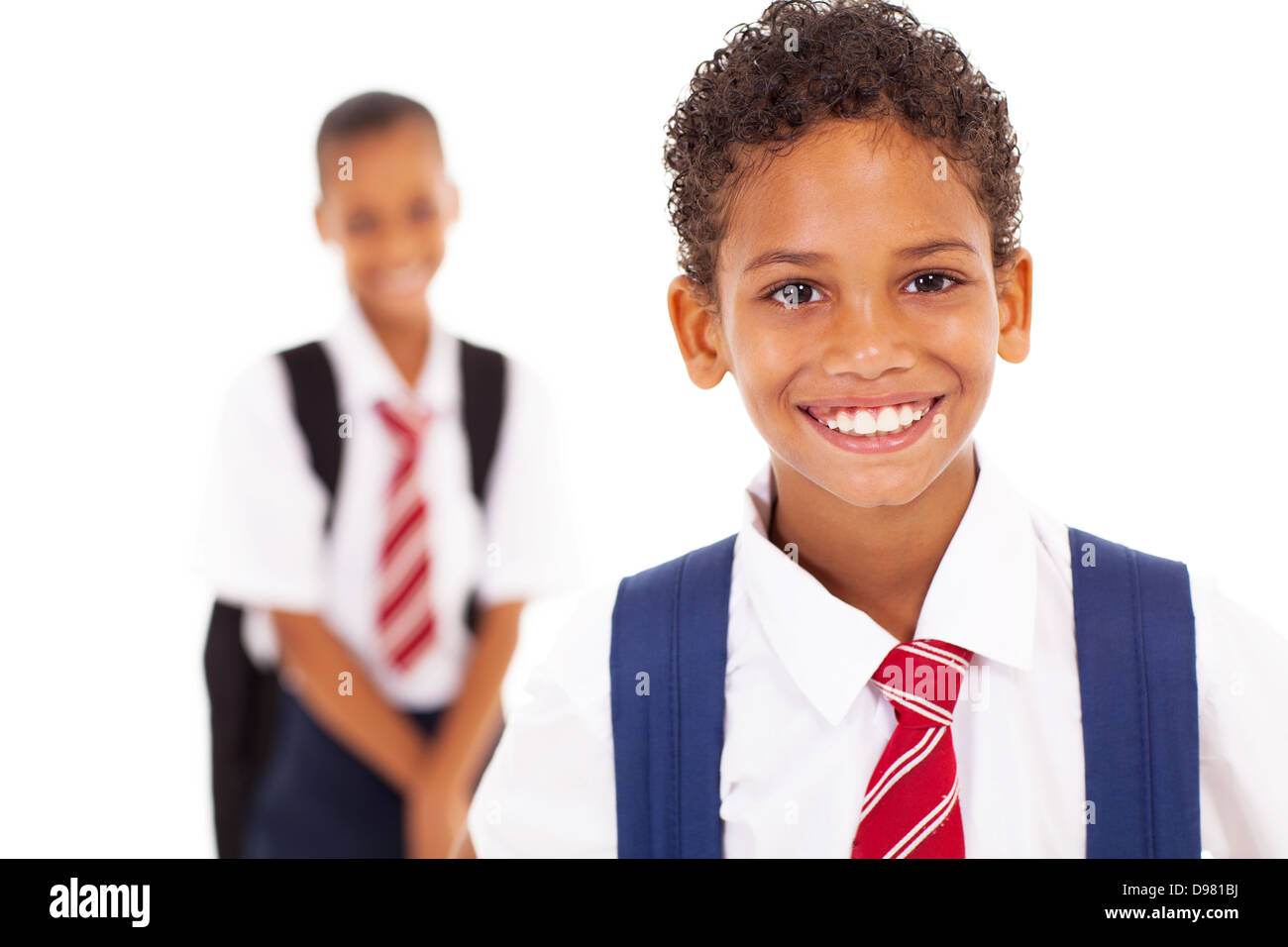cute elementary schoolboy in front of classmate - Stock Image