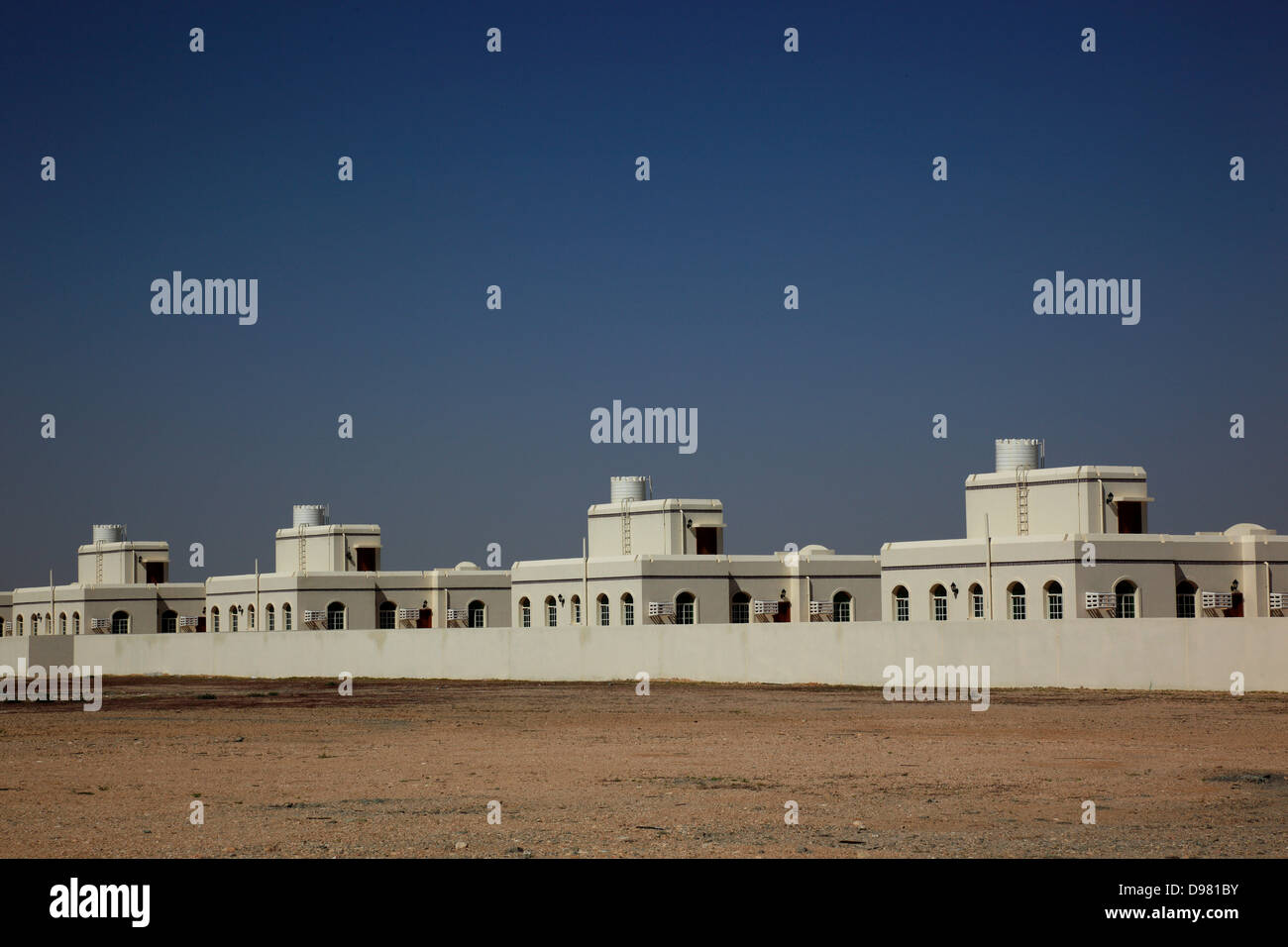 New building settlements, built by the state Oman for the resettlement of workers ?-lfelder, Oman - Stock Image