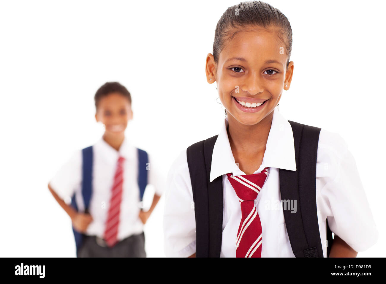 cute elementary schoolgirl in front of classmate - Stock Image
