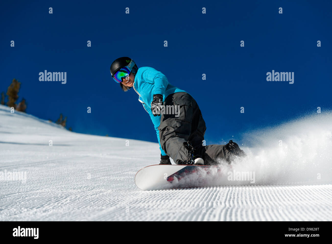 Snowboarder riding groomed trails at Mt. Rose Ski Tahoe ski resort near Lake Tahoe, in Nev. Stock Photo