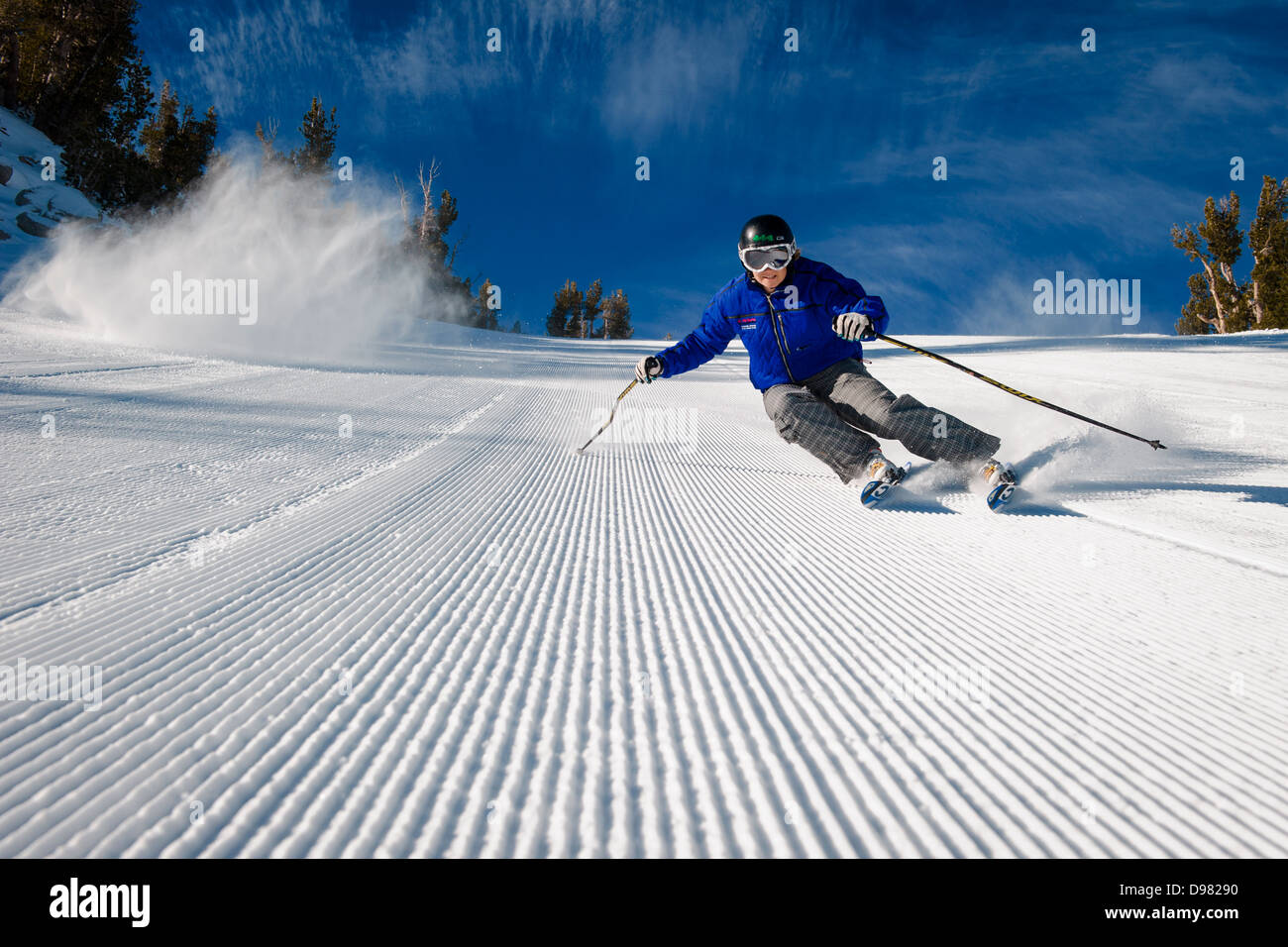 Skiing on the perfect groomed ski slopes at Mt. Rose Ski Tahoe ski resort near Lake Tahoe. Stock Photo