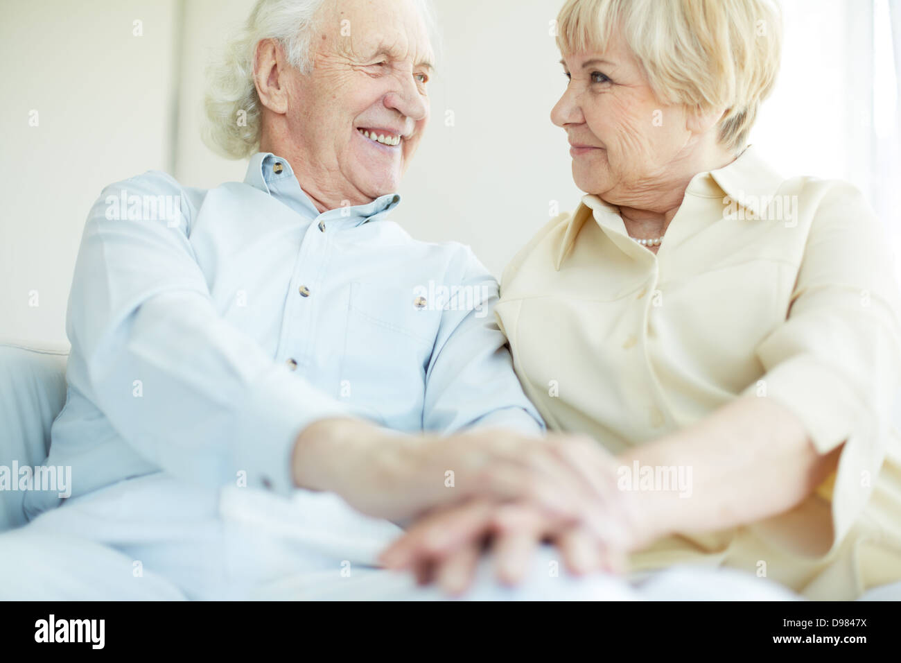 Happy elderly man looking at his wife - Stock Image