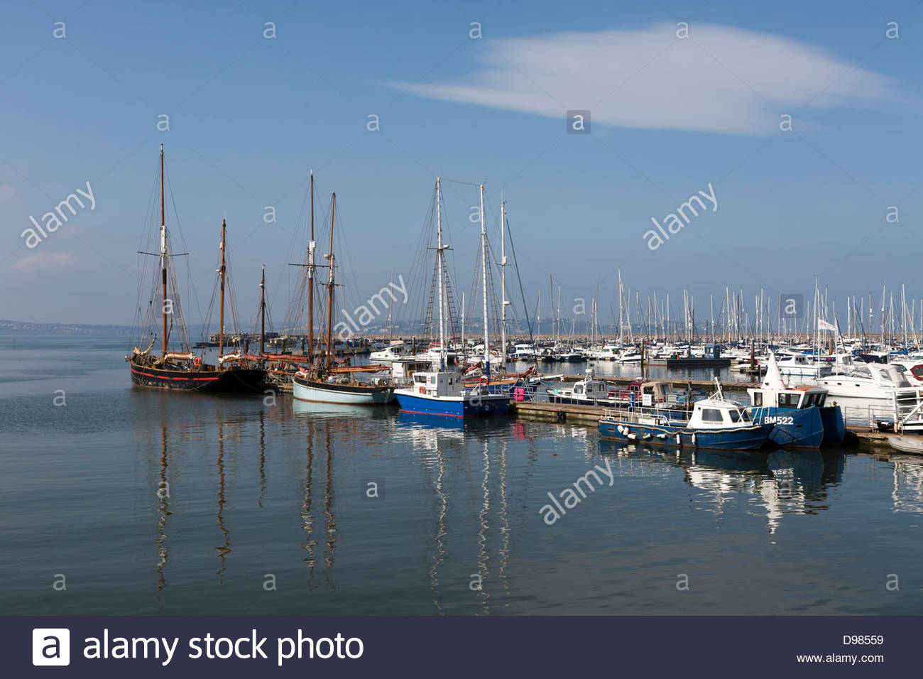 Sailing ketch and other sail boats at the deep water jetty, Brixham Harbour - Stock Image