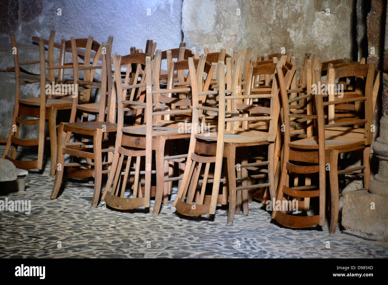Wooden chairs in a church. - Stock Image