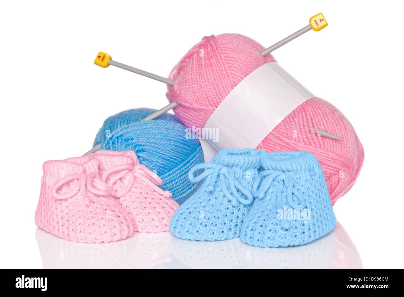 pink wool plus knitting needles