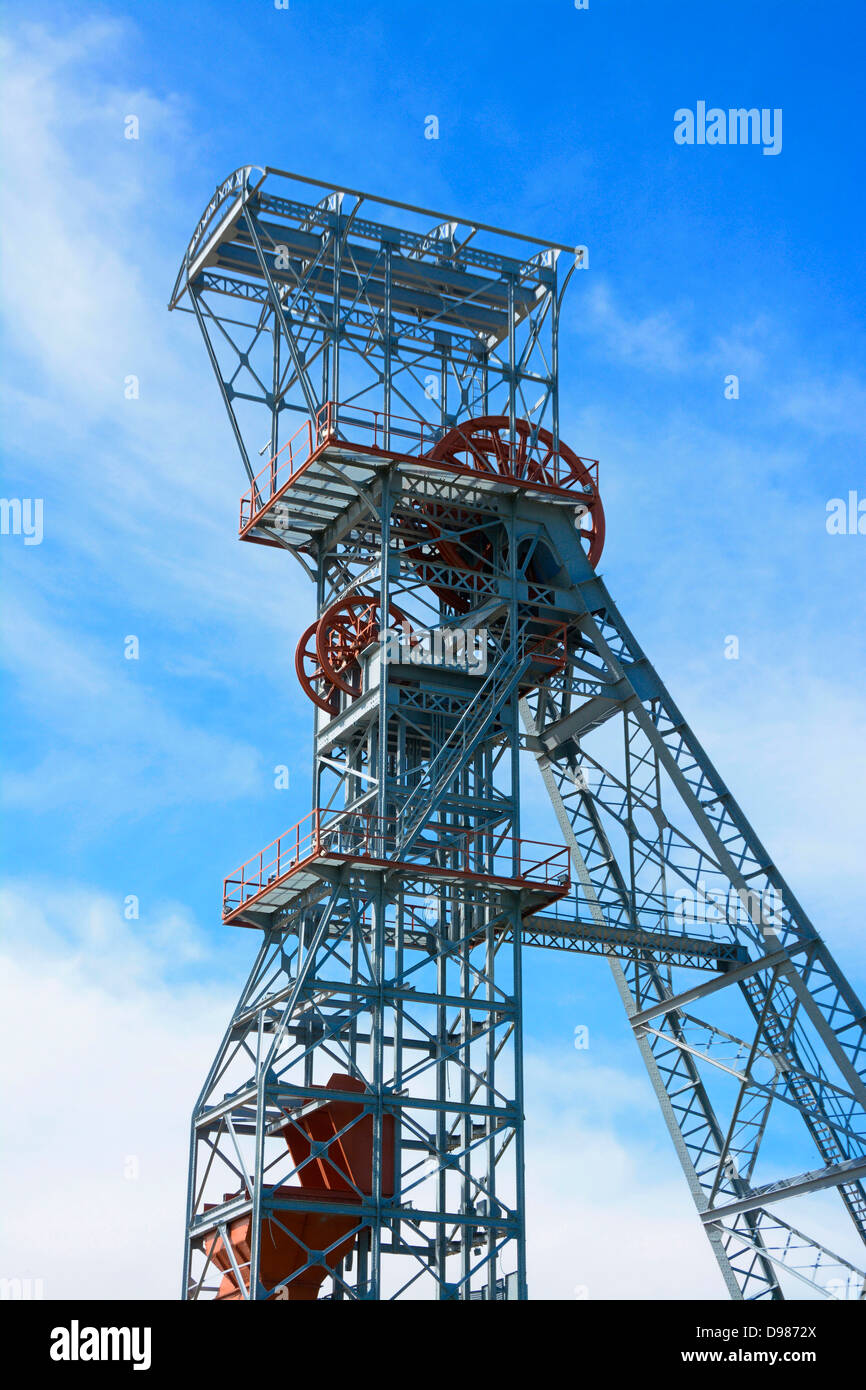 Old winding gear at a coal mine in Saint-Eloy les Mines, Puy de Dome, Auvergne, France, Europe - Stock Image