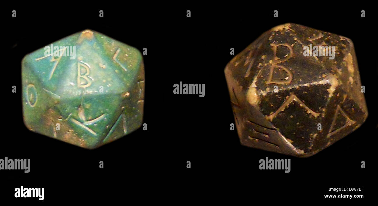 Steatite polyhedron inscribed with letters of the Greek alphabet. 2nd–3rd century A.D.  with a faience polyhedron - Stock Image