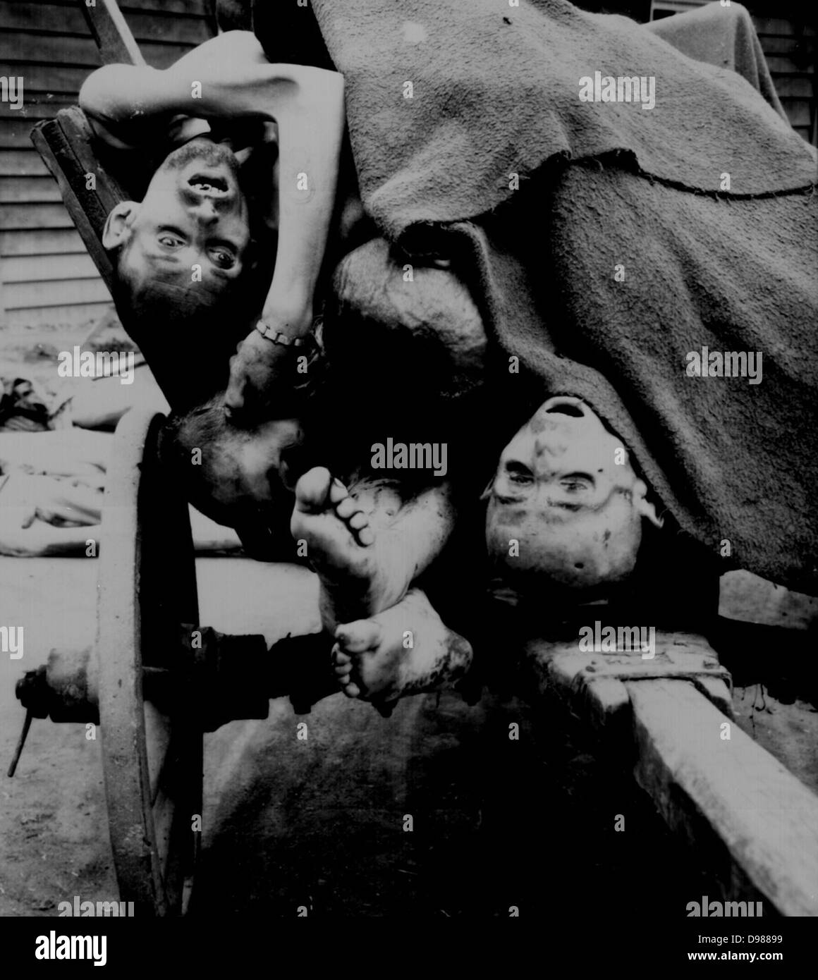 bodies being removed by German civilians for  burial at Gusen Concentration Camp, Muhlhausen, near Linz, Austria - Stock Image
