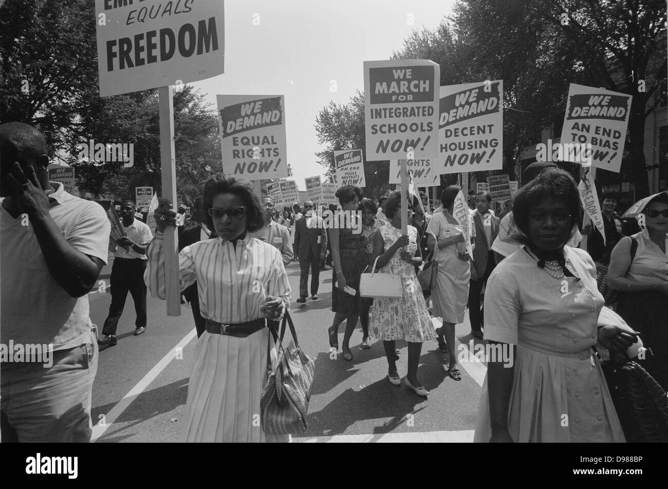 Civil rights march on Washington, DC, USA. Procession of African Americans carrying placards demanding equal rights, - Stock Image