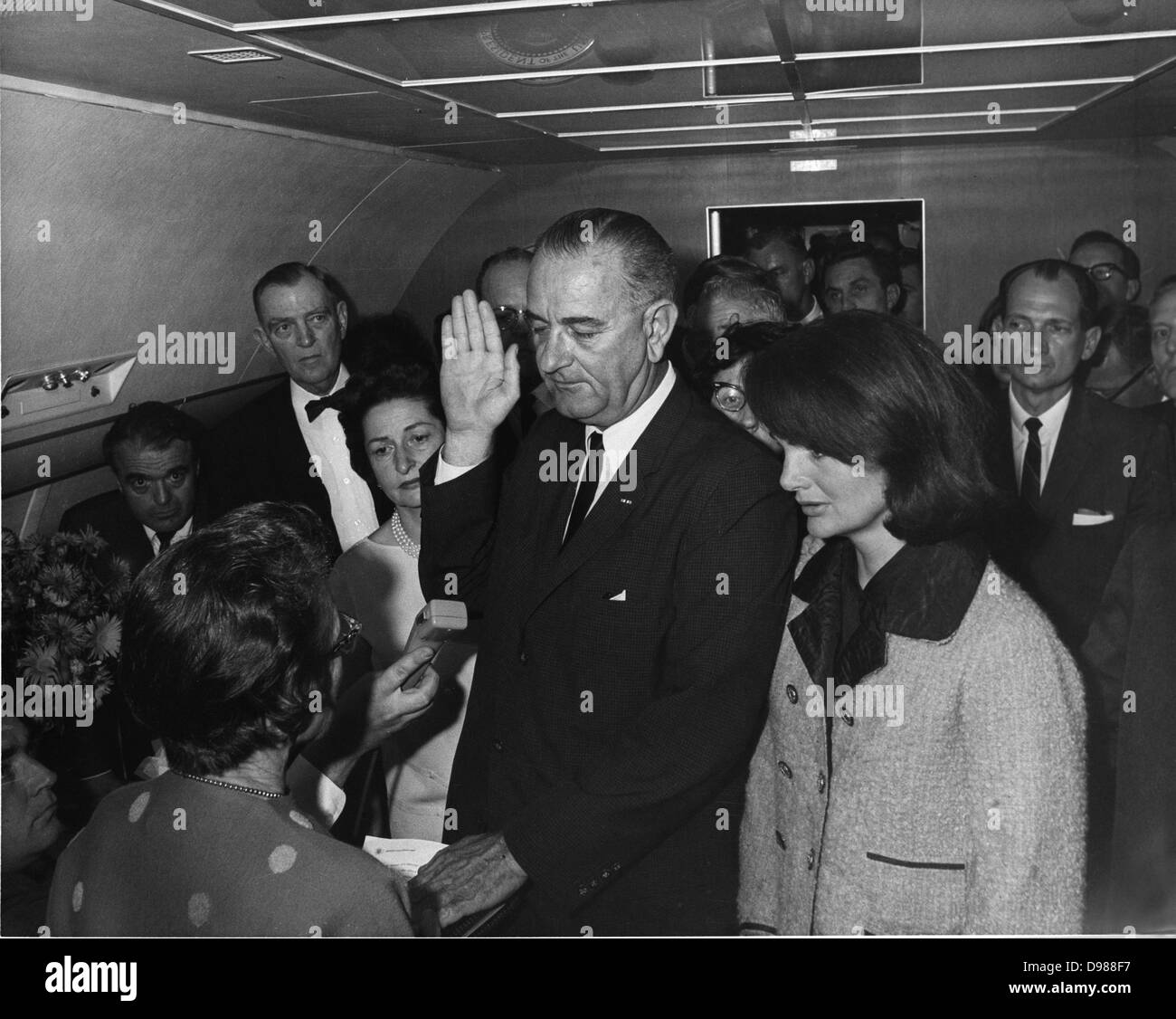 Swearing in of Lyndon Baines Johnson (1908-1973) as 36th President of the United States, 22 November 1963. The ceremony took place on Air Force One, Love Field, Dallas, Texas. At his side is Jackie Kennedy, widow of the assassinated president, John F Kennedy. LBJ Library, photo by Cecil Stoughton. Stock Photo