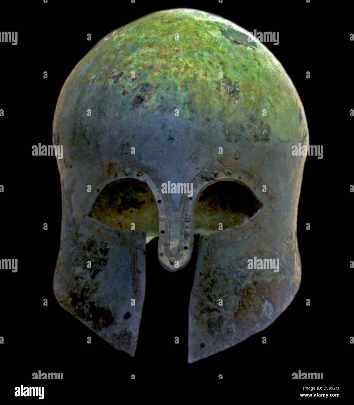 Bronze Helmet (Corinthian) Ancient Greek Circa 600 BC.  Shows repair over a hole. - Stock Image