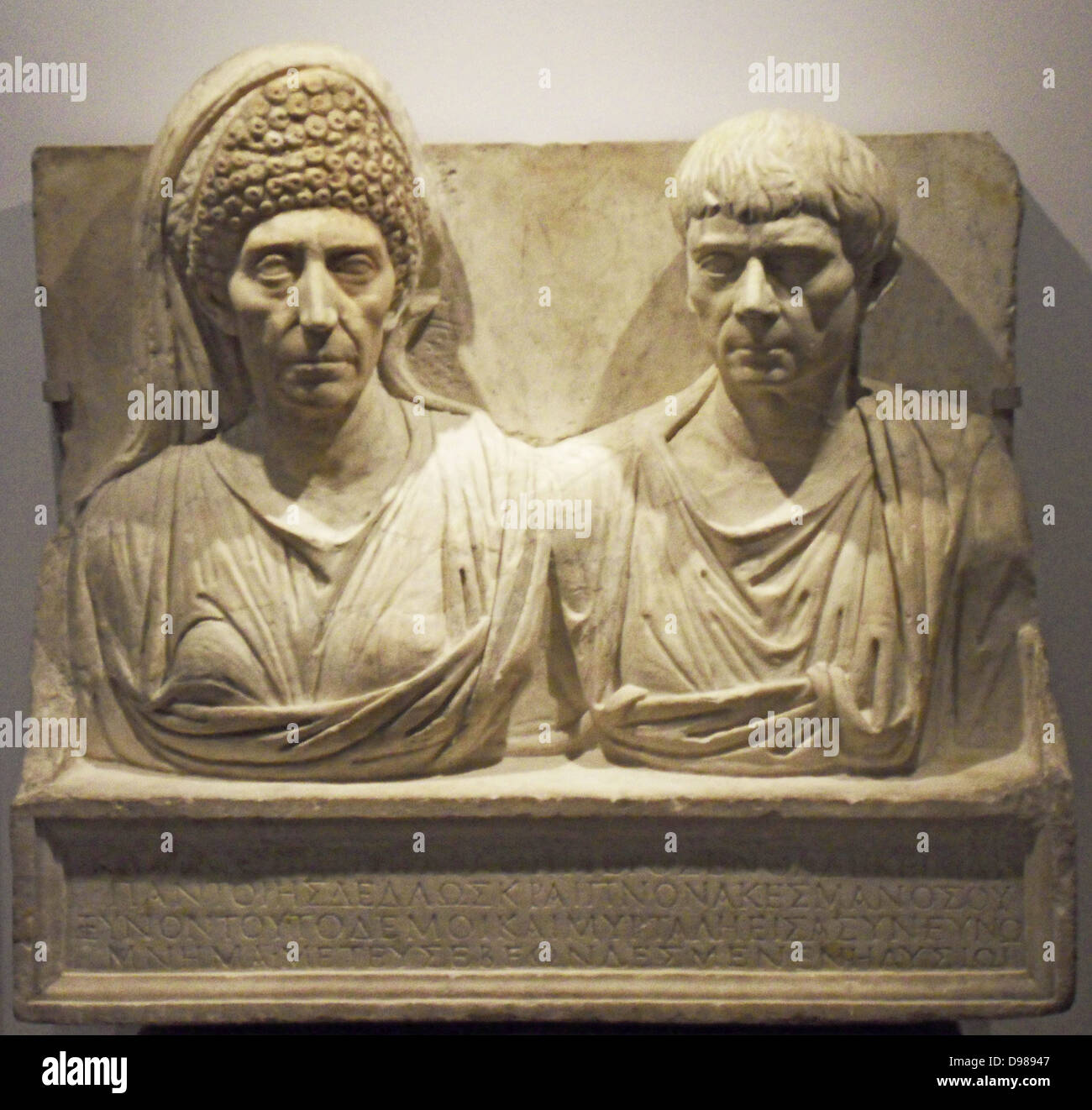 Marble tombstone of the doctor Claudius Agathemerus and his wife Myrtale.  Rome circa 100 AD. - Stock Image