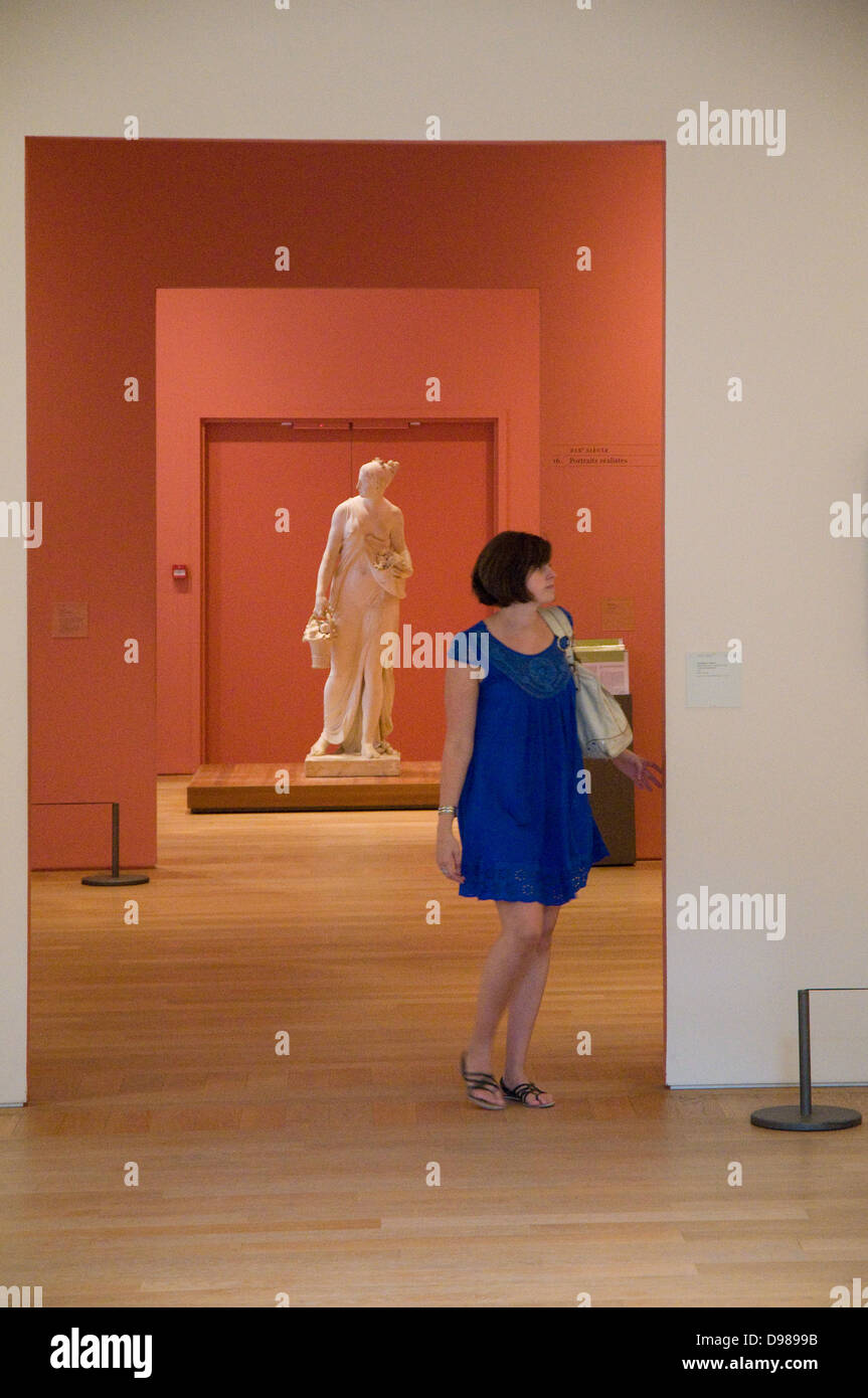 """A young girl in dark blue dress visiting the """"Petit Palais Museum"""" in Paris Stock Photo"""
