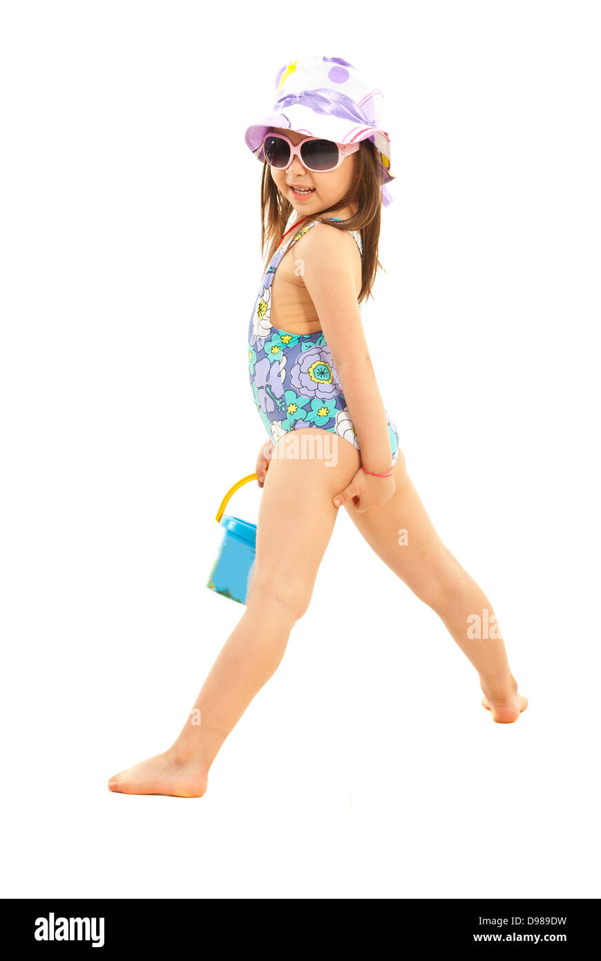 803d90084b12f Cute little girl in swimsuit ,sunglasses and sun hat posing isolated on  white background
