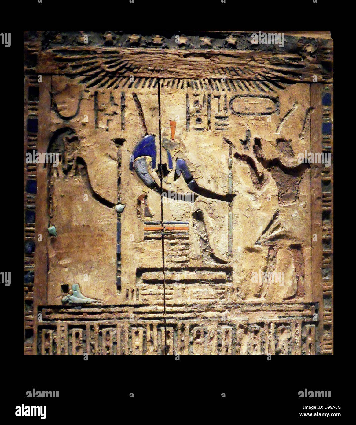 Darius dressed as Pharaoh of Egypt.  This wooden door shows Darius 1 (521-486) dressed as pharaoh on the right. - Stock Image