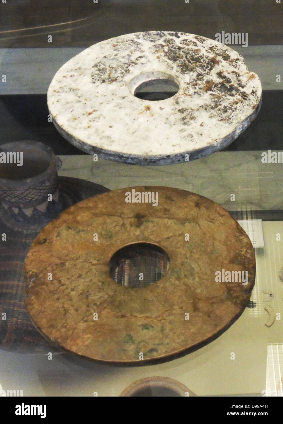 Chinese Neolithic Jade Bi Discs, Xia Dynasty (2100-1600BC) Stone rings were being made by the peoples of eastern - Stock Image