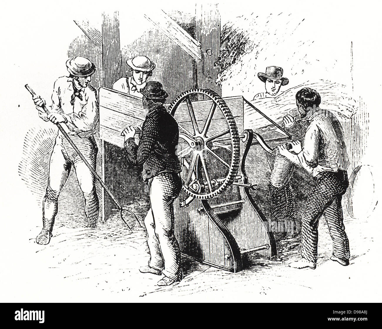 Hand-powered threshing machine by Barrett, Exall & Andrews. These machines were more efficient than the traditional - Stock Image