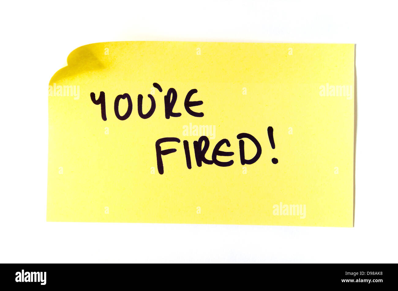 You're Fired! Written on a yellow post it note - Stock Image