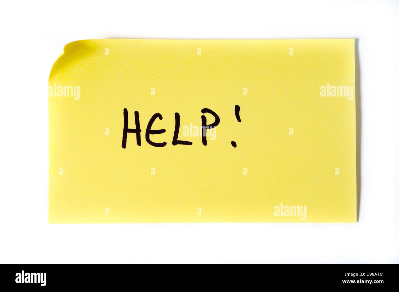 Help! Written in capital letters on a yellow post-it note - Stock Image