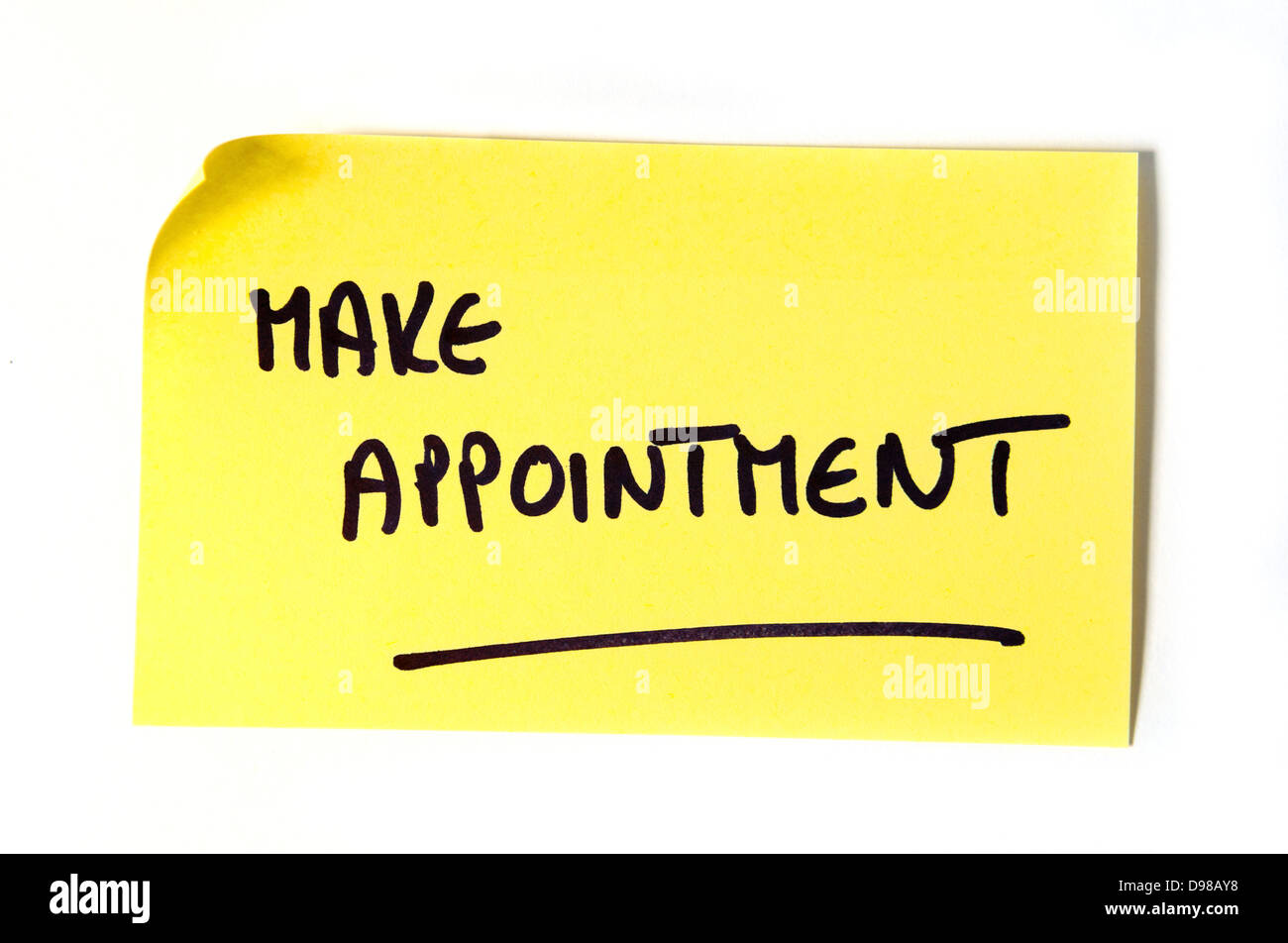 Make appointment written in capital letters on a yellow post-it note - Stock Image