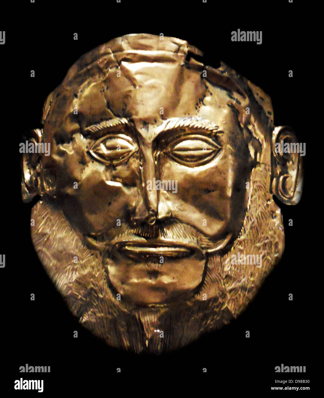 The Mask of Agamemnon is an artefact discovered at Mycenae in 1876 by Heinrich Schliemann. The mask is a gold funeral - Stock Image