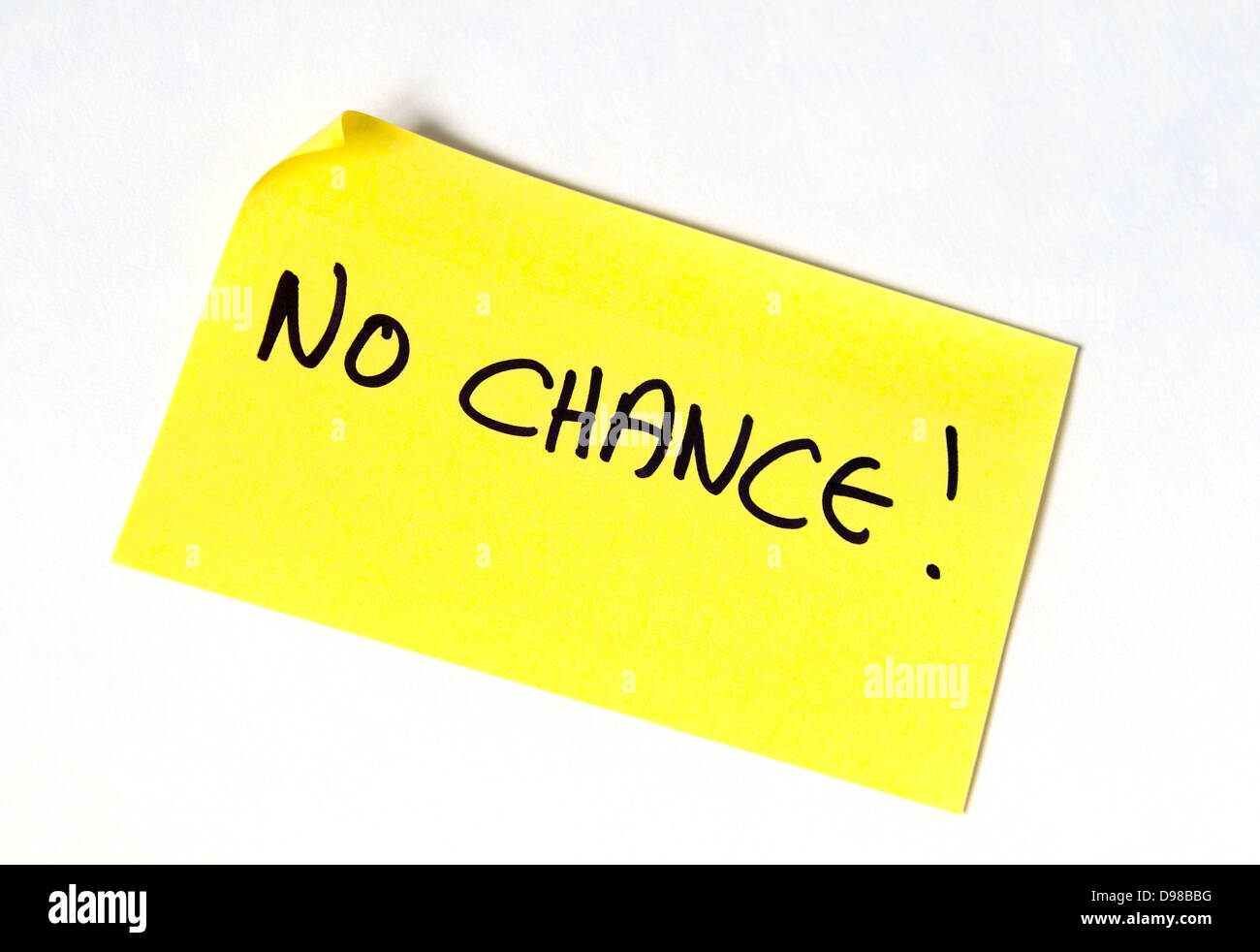 No Chance! Written in capital letters on a yellow post it note - Stock Image