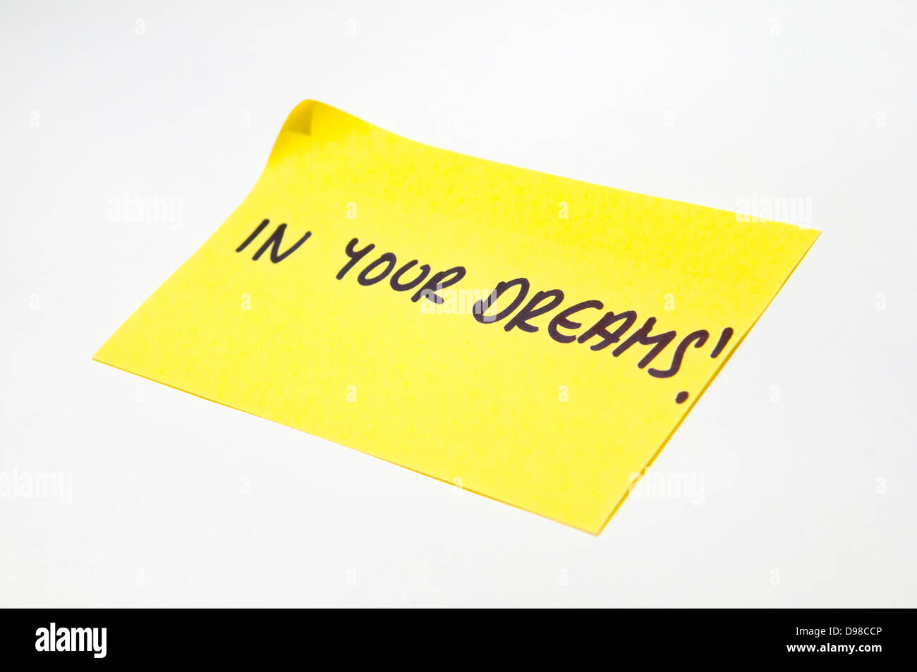 'In Your Dreams' written on a yellow post it note - Stock Image