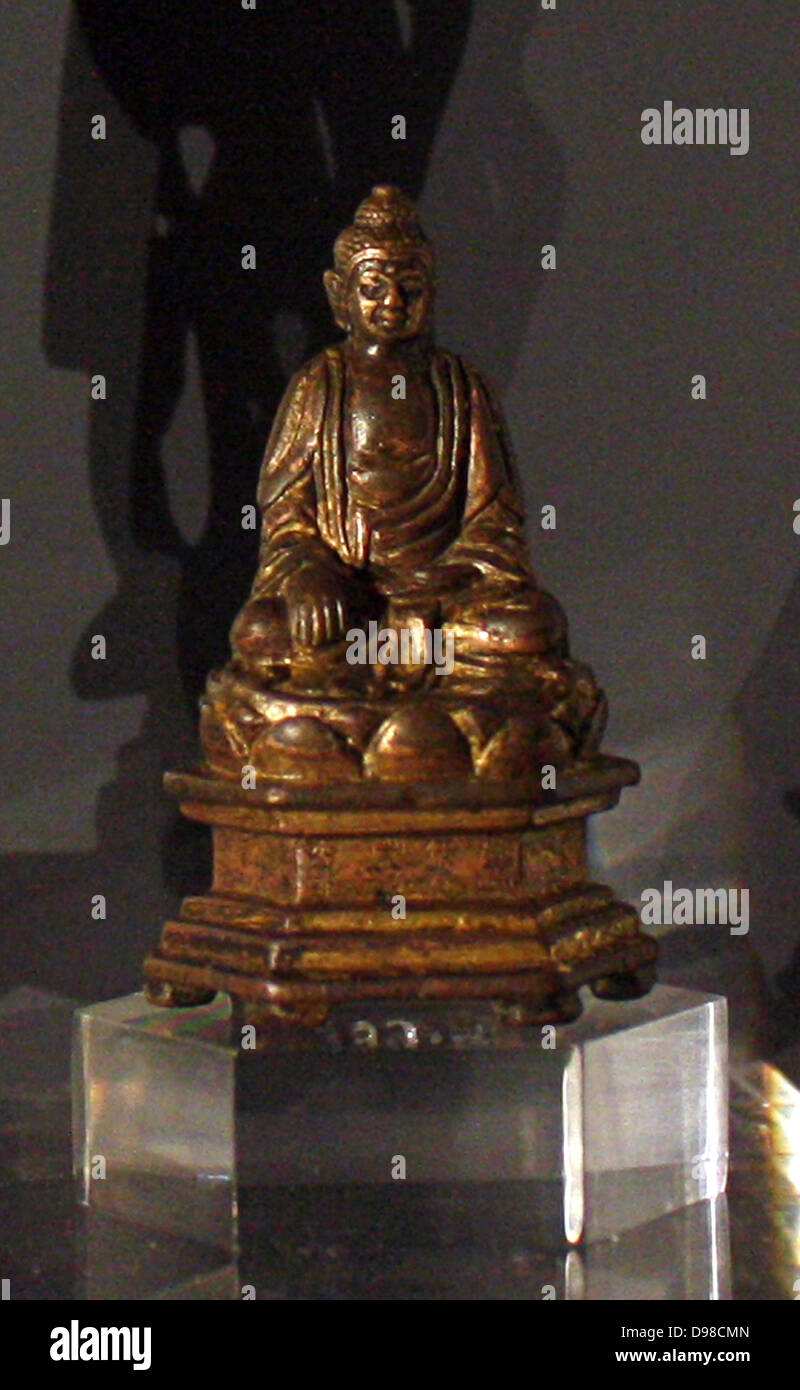 Seated Buddhist figure, gilt bronze, dated 1396. - Stock Image