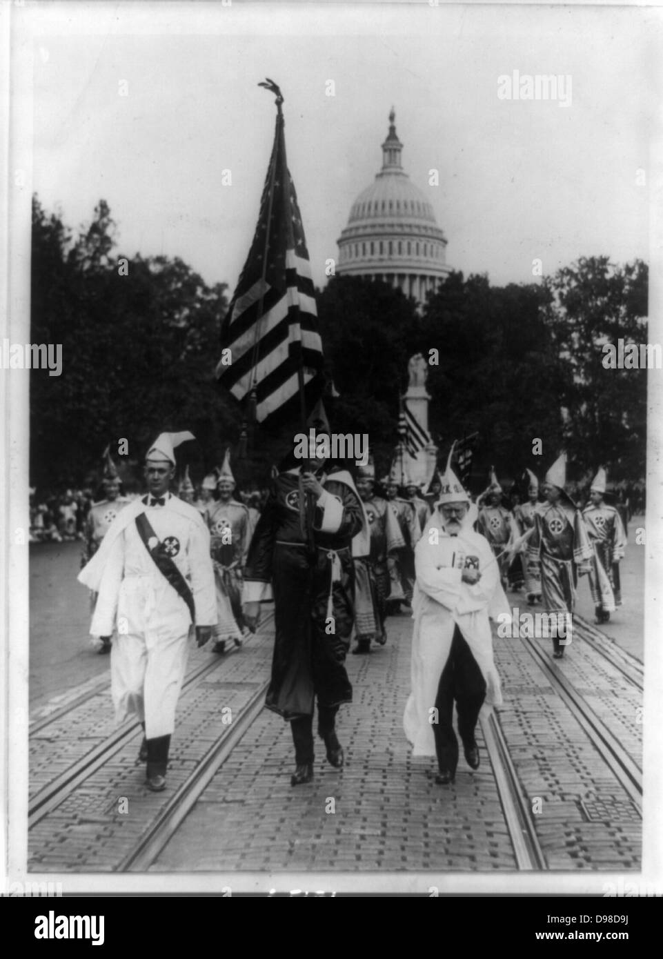 Parade of the Ku Klux Klan, in regalia and carrying the stars and stripes, through counties of Virginia bordering - Stock Image