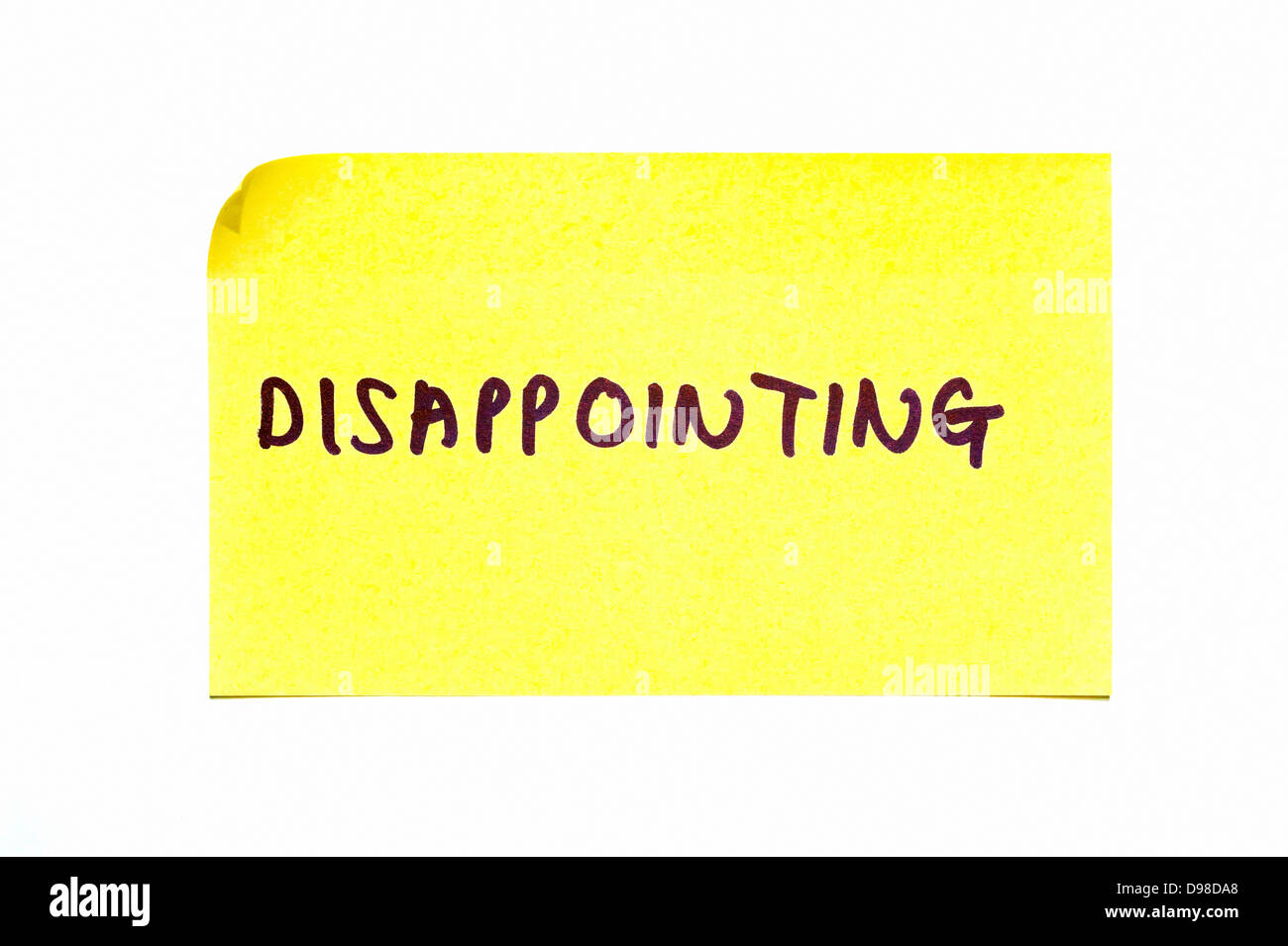 'Disappointing' written on a yellow post it note - Stock Image