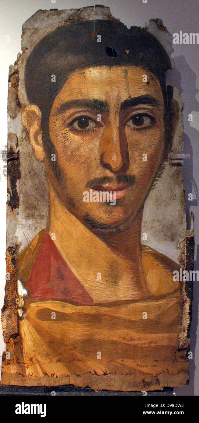 Portrait painted in encaustic on wooden panels, once fitted over the faces of mummified corpses. A young man, perhaps - Stock Image
