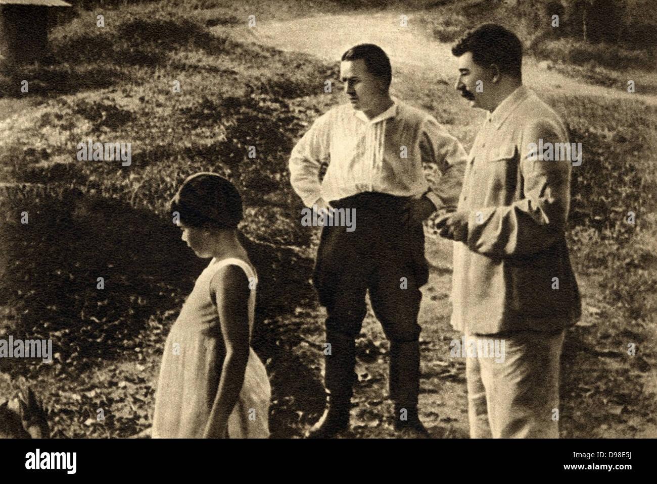 Sergei Kirov (1886-1934) early Bolshevik leader, centre, with Joseph Stalin and his daughtert Svetlana. - Stock Image
