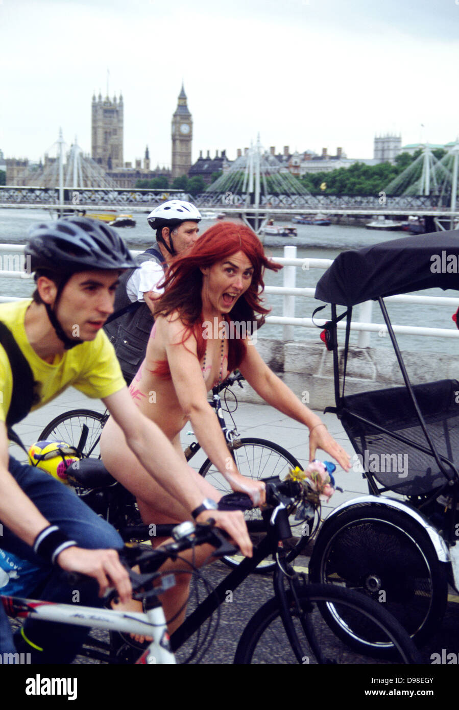 Naked Woman Cycling Between Two Clothed Men on Westminster Bridge, World Naked  Bike Ride, London, England
