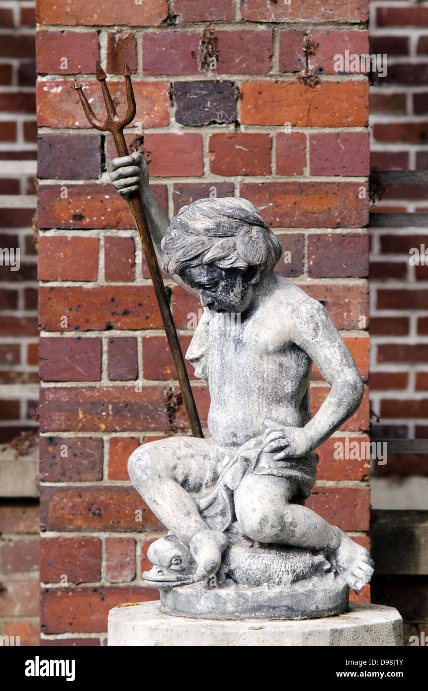 A statue of a baby poseidon. - Stock Image