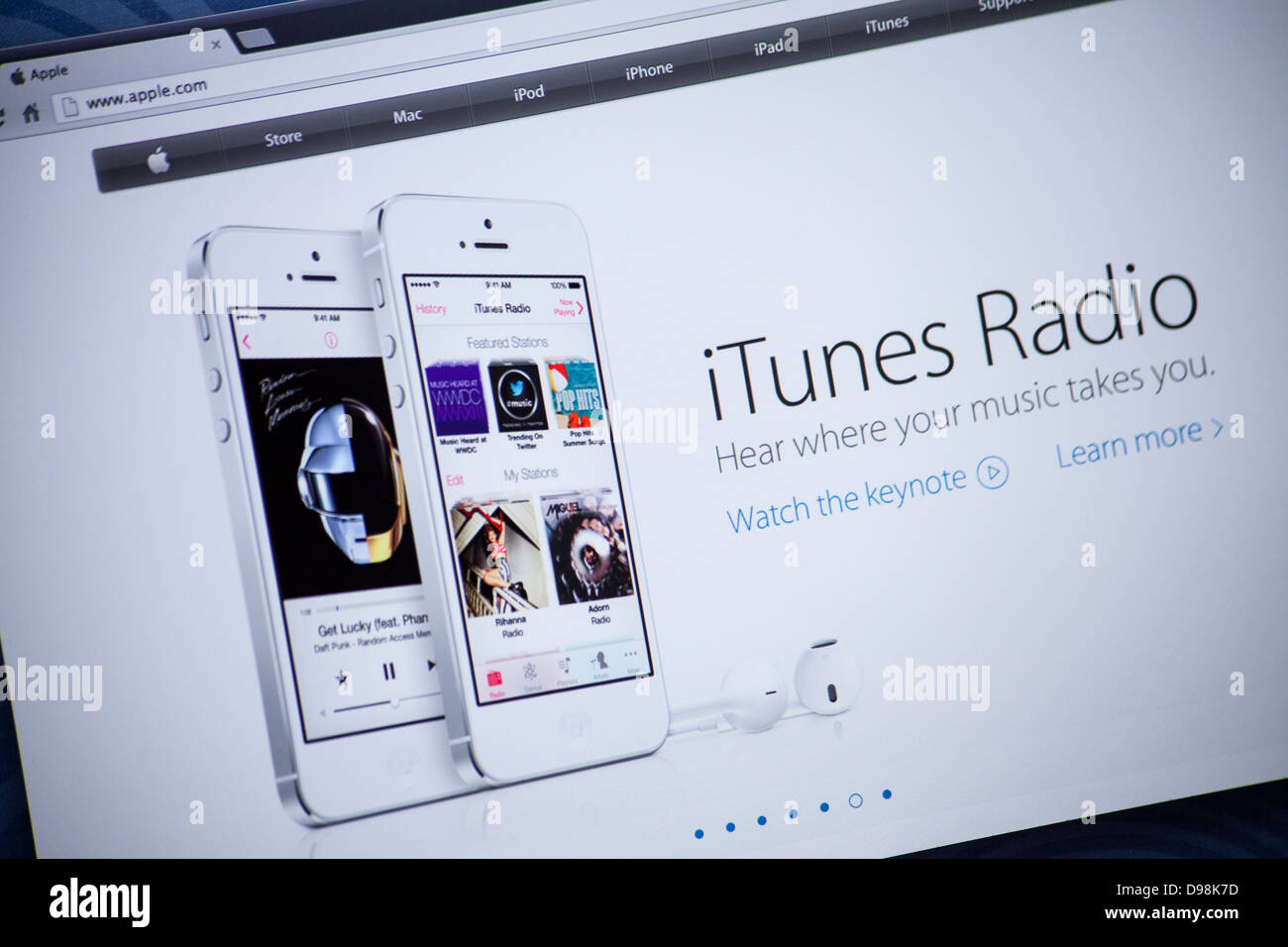 Apple website screenshot with iTunes Radio presentation page - Stock Image